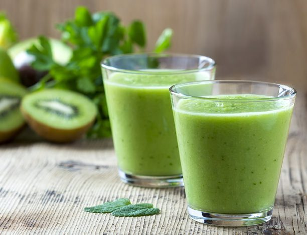 Healthy green Smoothie on wooden table